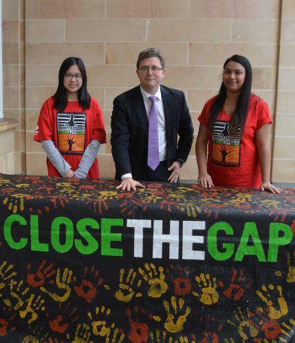 North Metropolitan MLC Tjorn Simba (middle) Close the Gap campaigners with Scarlett Li and Nikita Nayar.
