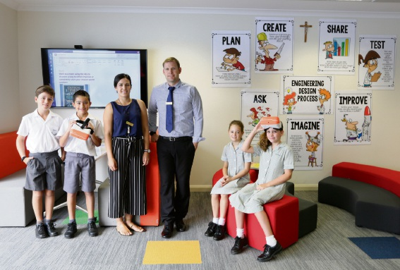 St Pius X Year 5 students Mathew Hawkins, Ocsar Pino, Adrienne Breglia (teacher), kim Hughes (assistant principal), Olivia Creek and Matilda Thomson.