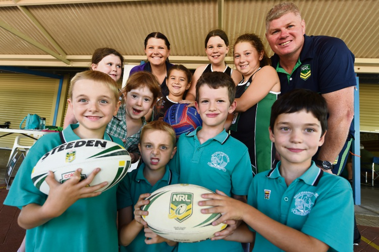 Emalee Romeo, back left, with NRL game development officer Shane Buttle and Halls Head primary students. Picture: Jon Hewson.