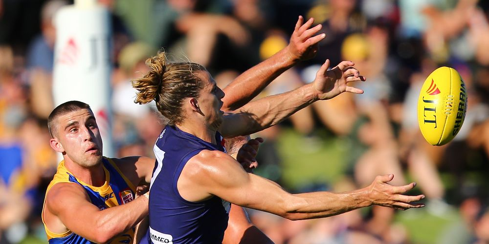 PERTH, AUSTRALIA - MARCH 11: Nathan Fyfe of the Dockers contests a mark during the JLT Community Series AFL match between the Fremantle Dockers and the West Coast Eagles at HBF Arena on March 11, 2018 in Perth, Australia.  (Photo by Paul Kane/Getty Images)