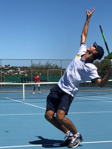 Cottesloe's Will Hann serving.