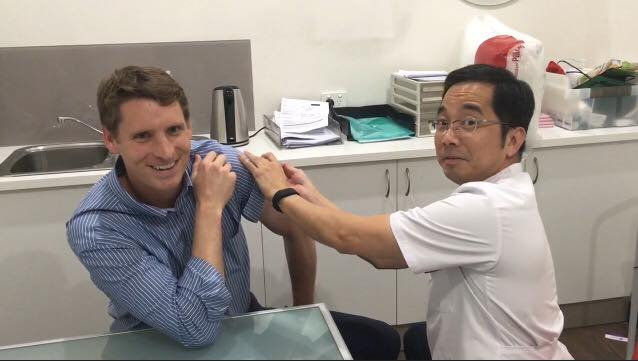 Canning MHR Andrew Hastie gets his flu vaccination at Pinjarra Pharmacy.