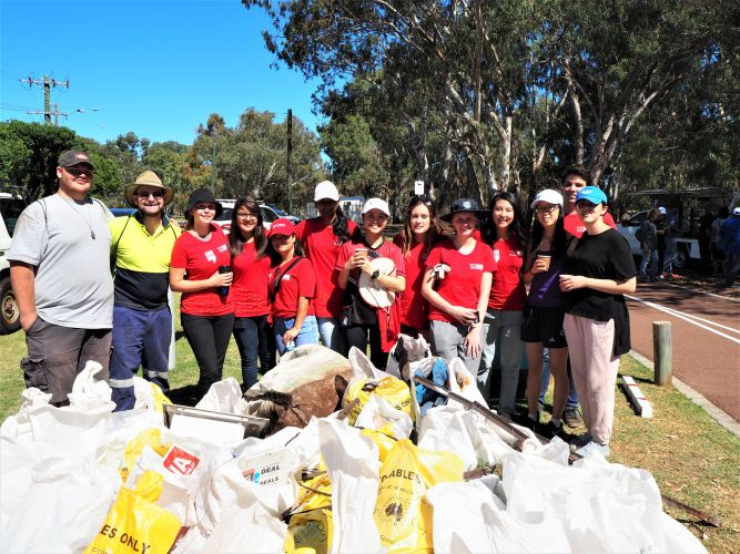Murdoch Guild volunteers with bags of rubbish cleared from Adenia Park for Clean Up Australia Day.