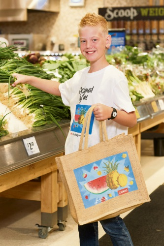 Charlie De Bruyn with the reusable shopping bag he designed.