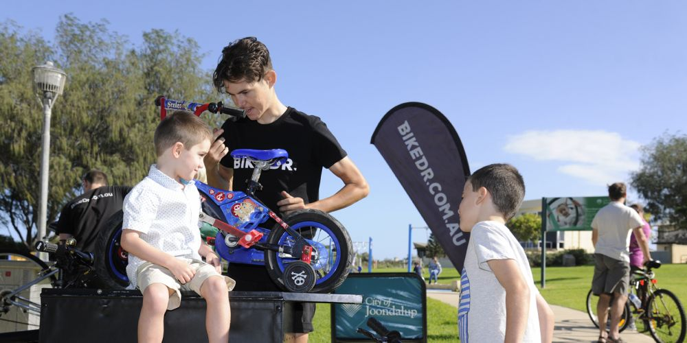 Noah and Juani Macey have their bikes looked over by a Bike Doctor mechanic.
