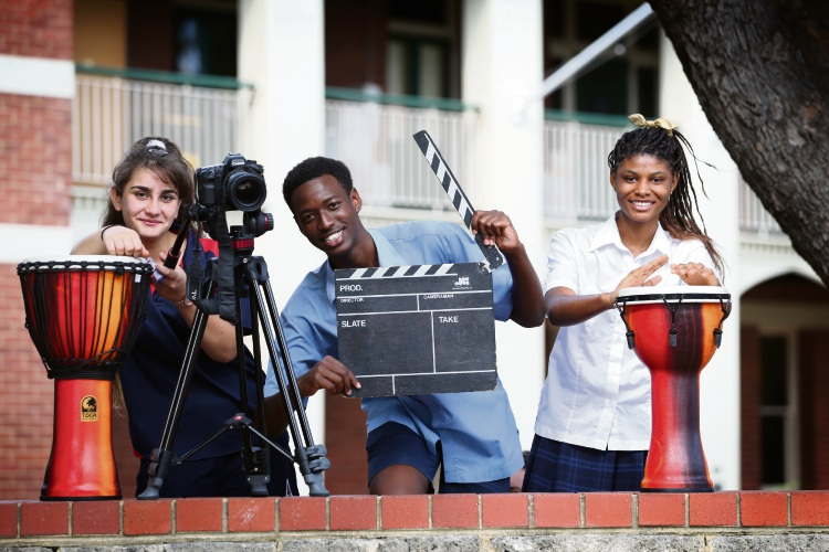 Rita Yousif (y8), Frank Mucho (y12) and Kalungila Lutombo (y11). group of young migrants from multilingual backgrounds are the stars of a new music video that calls for all cultures living in Australia to be united, accept each other and live in happiness and peace. Photo: Andrew Ritchie