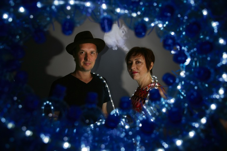 Artists (l-r) Roly Skender and Kathy Allam are all lit up for the fourth annual ArttraOK Festival in Claremont Park. Picture: Andrew Ritchie.