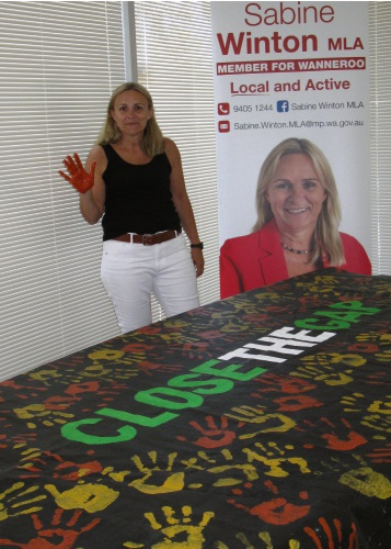 Wanneroo MLA Sabine Winton with the Close the Gap banner.