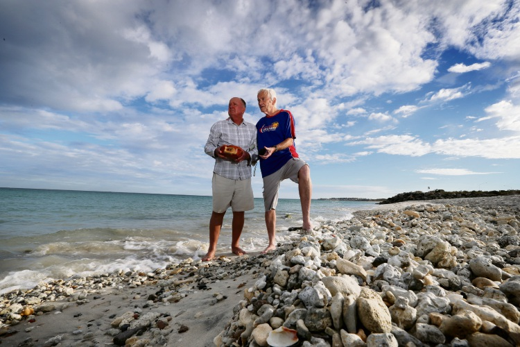 Beach walkers Peter McLarty, left, and Paul Martin want the FPA to honour commitments to clean up rubble and contamination Sandtrax and Port beaches. Picture: Andrew Ritchie.