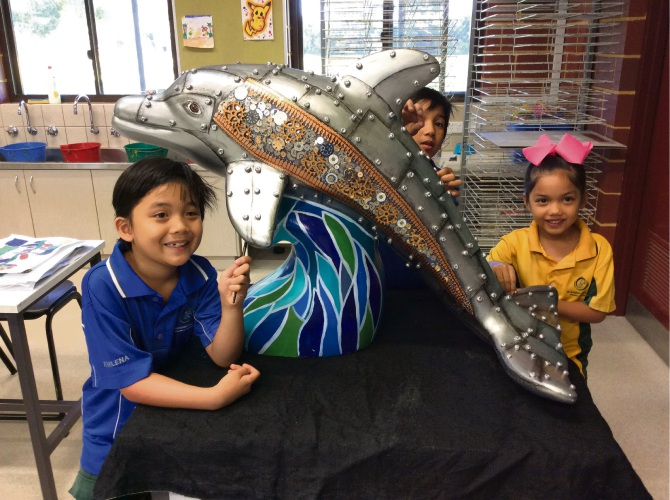 Rockingham Beach Primary School students Roane Perkins, Rion Perkins and Kylar Perkins with Robo Flipper.