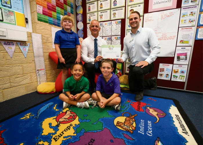 Year 1 Students Georgia Marsh, Ariana Rawhiti, Storm Peck with Principal Matt Jarman and Jackson Deegan of Woolworths with the Woolworths donated classroom rug. Picture: Matt Jelonek d480164