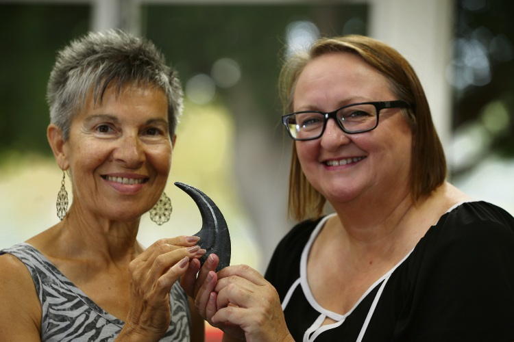 Anita Krefel (resident) and New Museum for WA project director Trish McDonald holding a dinosaur claw. Picture: Andrew Ritchie www.communitypix.com.au d480586