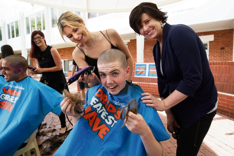 Hairdresser Rhianna Taggart (left), James McMullen and his mother Fiona. Photo: Bruce Hunt