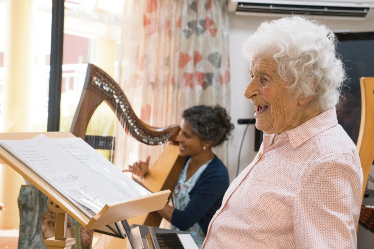 Harp Harmonies members Gina Rogers (96) with Shamara De Tissera performing for Osborne Park residents.