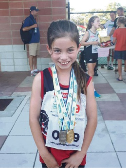 Leah Allen with her medals.