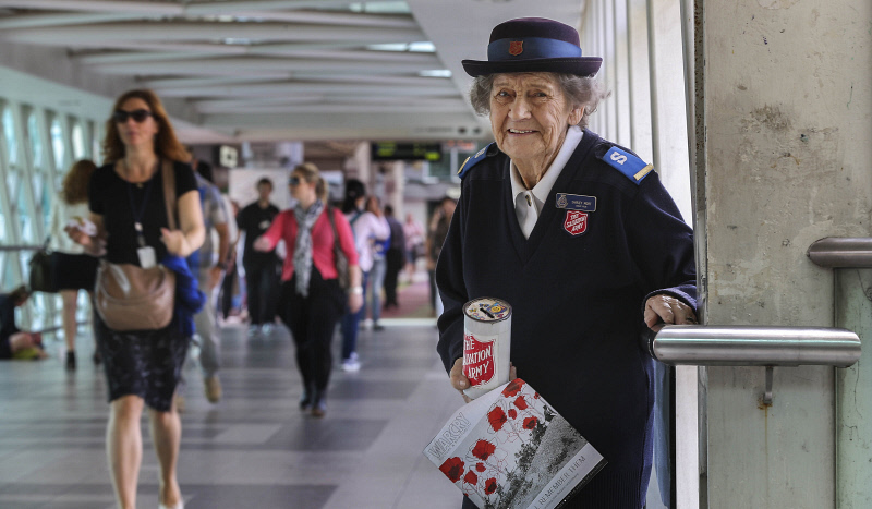 Salvation Army collector Shirley Mort, in 2015, at her post on the Wellington Street overpass in Perth city. Photo:: Nic Ellis, The West Australian