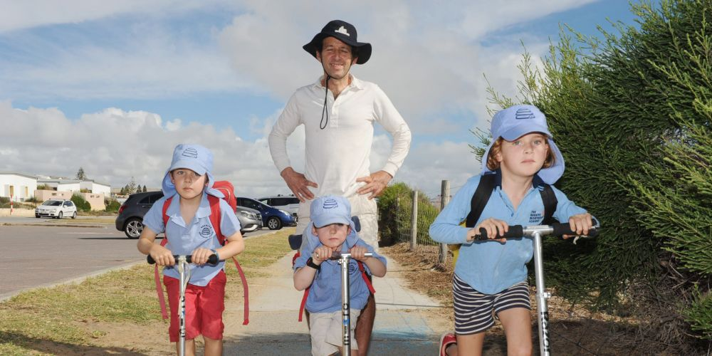Montessori Beehive students James (5), Thomas (4) and Charlotte (7) Chrichton, with dad Ronald Critchton, will scoot or cycle on Ride2SchoolDay next Friday. Picture: Jon Bassett.