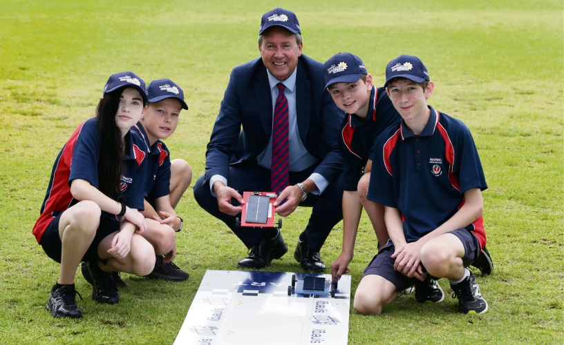 Parliamentary Secretary Reece Whitby with year 8 students Tamsin Dewar, Riley Wills, Angus Hamilton and Karl Pegler. Picture: Martin Kennealey d480572