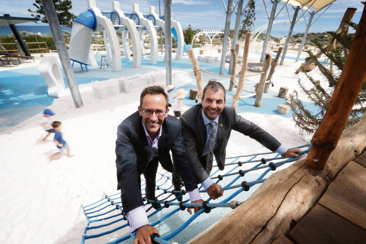 Metropolitan Redevelopment Authority chief executive Sean Henriques and Stirling Mayor Mark Irwin giving the new playground a test run. Picture: Andrew Ritchie d480742