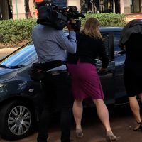 Defence lawyer Neish Rados helps Julia Betrenko into a car after the hearing. Picture: Mark Donaldson