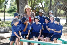 Woodbridge Primary School deputy principal Lawri Bryden with students.  They are raising funds for more nature play equipment. Picture:Woodbridge PS/Coles