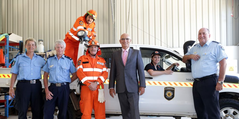 Cora Babenschneider and Derek Young from the Two Rocks Volunteer Bush Fire Brigade with Hamish Barton, Max Ross and Courtney Farley from Two Rocks SES and Butler MLA John Quigley and DFES district officer Graham Sears. Picture: Martin Kennealey d480060