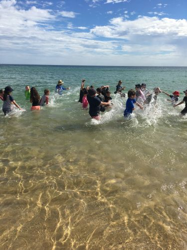 Ocean Road Primary Year 5 Students cooling down after tug-o-war.