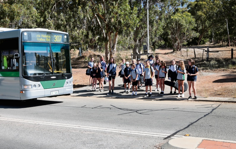 Students getting off a bus near the corner of Scott Street and Helena Valley Road in Helena Valley. Photo: David Baylis