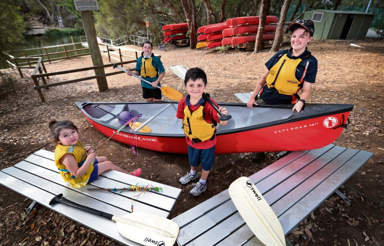 L-R: Eve (3) holding a Magical Bush Wand, Dusk (11) and Ryder (6) Ulgen of Maddington with Bickley Trainee Juliette Cox from Bickley Outdoor Recreation Camp.  Looking forward to the Bickley Outdoor Recreation Camp open day. Picture: David Baylis www.communitypix.com.au   d480793