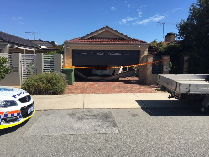 A car hit another vehicle and a house in Kewdale.