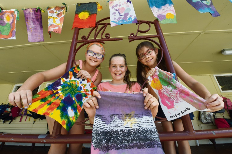 Millen Primary School students Zoe Bizzaca, Lucy Taylor and Claire Den Hollander with some of the flags. Picture: Jon Hewson.