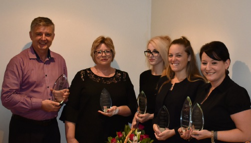 Raine & Horne WA general manager Craig Abbott presents awards to Raine & Horne Rockingham Beach property managers Marianne Henderer and Katelyn Lilleyman and property manager assistants Chantelle Tuddenham and Alida Zuvela.