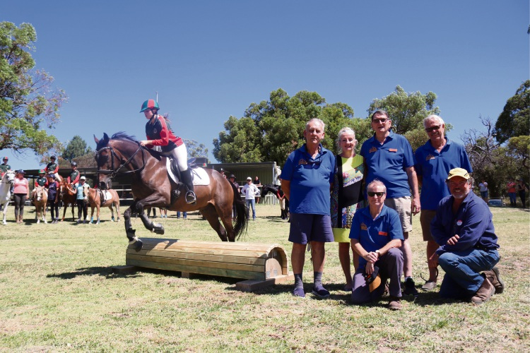 Wanneroo Mayor Tracey Roberts with Northern Suburbs Men's Shed members (standing from left), Doug Martin, George Day, Peter Krynen and, kneeling, Ken Kingwell and Wanneroo Horse and Pony Club president Mike Agnew.