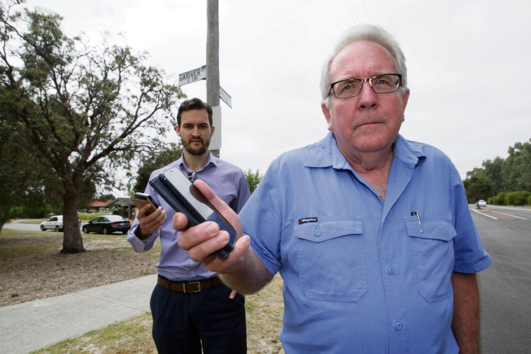 Melville deputy Mayor Matt Woodall and Leeming resident Peter Price. Telstra customers in the area say they receive little to no mobile coverage. The Telco says it is working to address the problem. Photo: Bruce Hunt