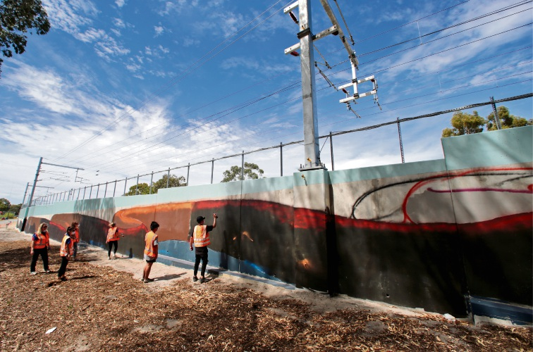 Tracking well: The Public Transport Authority is co-ordinating with artist Drew Straker on this mural at the Forrestfield-Airport Link.Picture: David Baylis  d480807