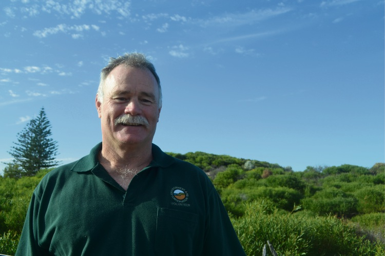 Volunteer reptile removalist Colin Slattery at City Beach.