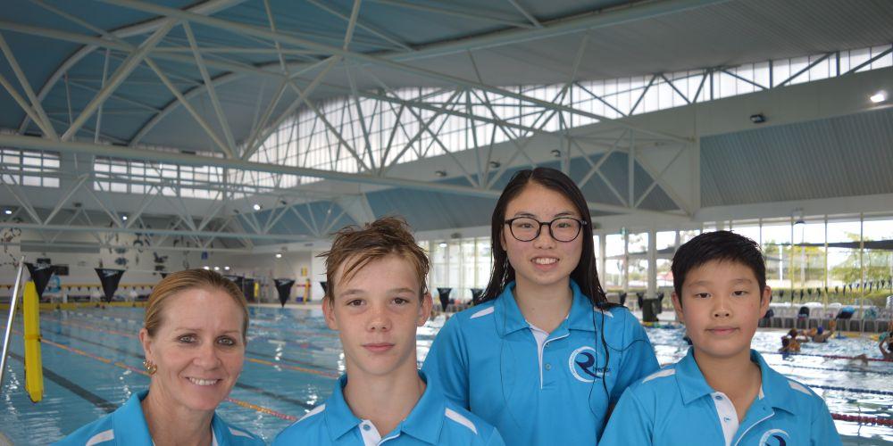 Head Coach Gemma Herrington, with Phoebe Woon, Jacob Hale and Brandon Ho.