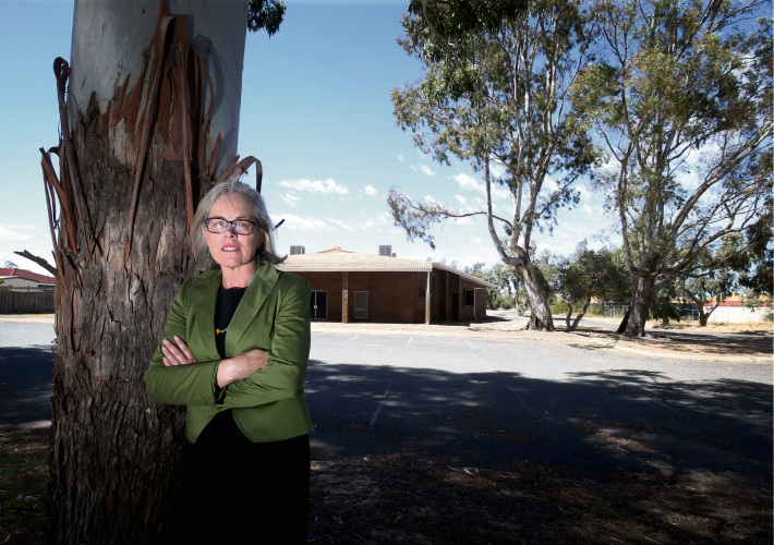 Janine Freeman outside the Koondoola Hall complex where the local government are demolishing the area due to the trees. Picture: Matt Jelonek d480899