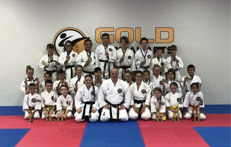 Gold Martial Arts chief instructor Mark Golding with members who competed in the recent Senshinkan Open.