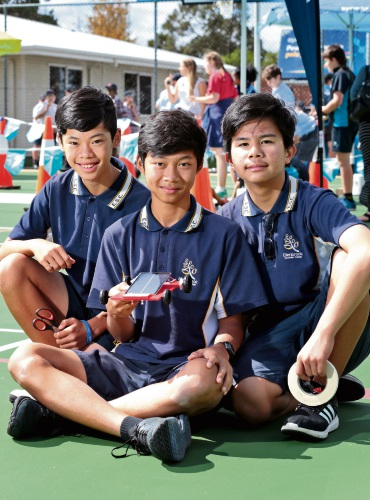 Kevin Nguyen (12), Timothy Jason (13) and Joshua Muyot (13) from Ellenbrook Secondary College. The eastern corridor semi-final of the 2018 Synergy Schools Solar Challenge took place at Mazenod College in Lesmurdie yesterday. Picture: David Baylis d481071