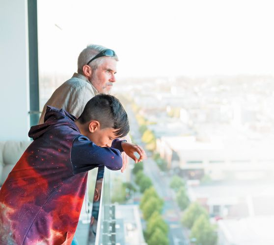Aidan Power and son Jack enjoying the view from their Oracle apartment.