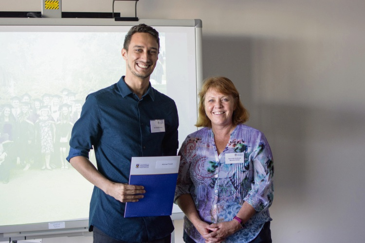 Michael Ponds is presented with the prize by Professor Annette George. Photo: Tonia Loke.