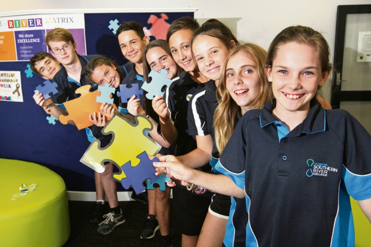 From front: Alysabeth Georgio, Bridget Poole, Courtney Otte, Calin Thorne, Payge Germaine, Maximus Miller, Stacey Greyling, Alex Williams and Dylan Richardson supporting Autism Awareness Week. Picture: Bruce Hunt