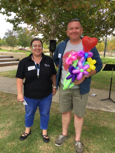 Kevin Frampton accepting his Neighbour of the Year balloon trophy from The Village at Wellard Residents Association Chair Claire Cardew.