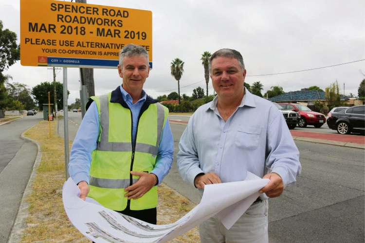 City of Gosnells engineering construction co-ordinator Darren Smith and Mayor Glenn Dewhurst look over plans as work on Spencer Road begins.