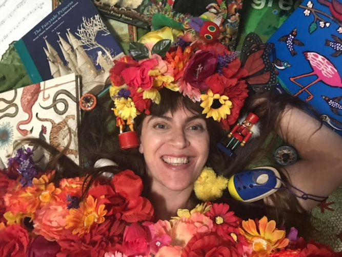 Narrator Danielle Joynt surrounded by books, music and toys. Photo: supplied