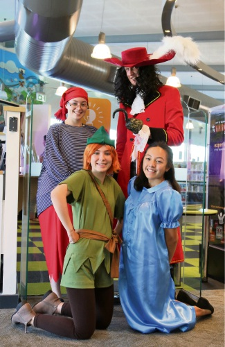 Production students Eve Basson (Smee), Lachlan Dawson (Captain Hook), Kyrah Victorien (Peter Pan) and Kya Moreno (Wendy) promoting Peter Pan at Clarkson Library.