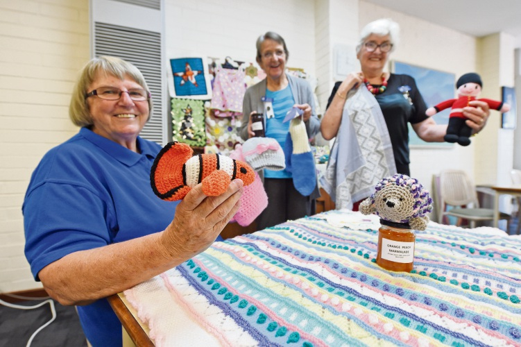 Victoria Park CWA treasurer Fran Sillitto, president Anthea Rogers and secretary Raylene Thomas with some of the items that will be on display at an upcoming exhibition. Picture: Jon Hewson.