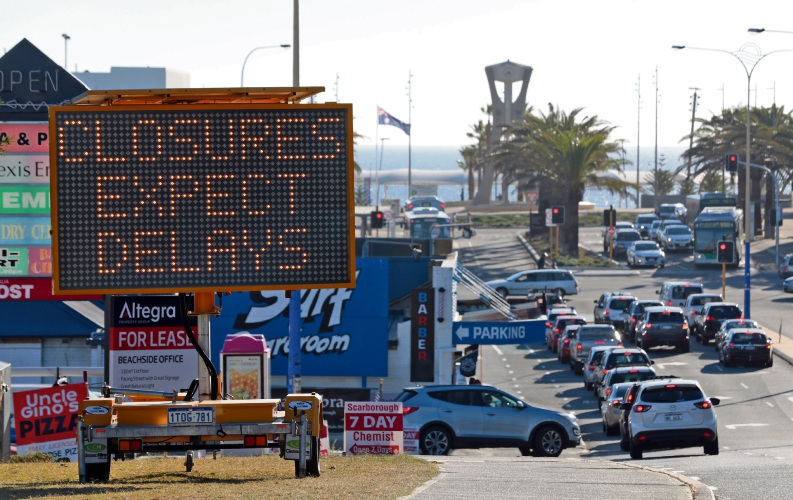 Flashing signs for the Aussie surf lifesaving titles. Photo: Martin Kennealey