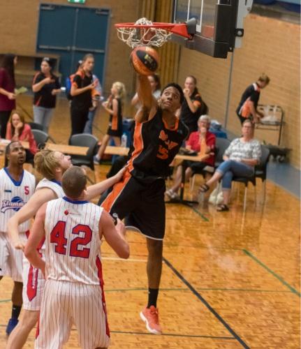 Kevin Davis slam dunks for the Eastern Suns.